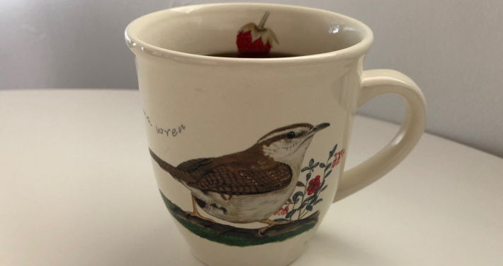 coffee mug with bird on it